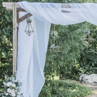 Ceremony arches with hanging décor