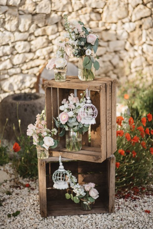 Stacked agricultural crates with flowers & hanging décor